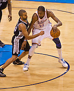 June 2, 2012; Oklahoma City, OK, USA; Oklahoma City Thunder forward Kevin Durant (35) dribbles the ball under pressure from San Antonio Spurs forward Kawhi Leonard (2) during a playoff game  at Chesapeake Energy Arena.  Thunder defeated the Spurs 109-103 Mandatory Credit: Beth Hall-US PRESSWIRE