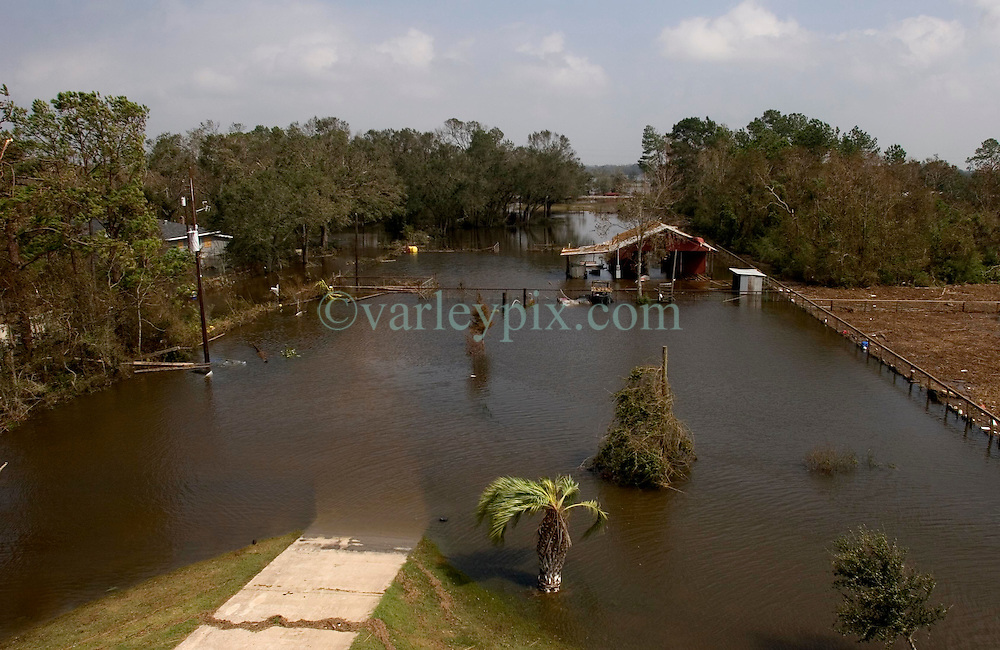 25 Sept, 2005.  Carlyss, Louisiana. Hurricane Rita aftermath. <br /> Carlyss, Louisiana (20 miles north of ravaged Cameron). One day after the storm hit. View from local cajun man Aaron Stokes' fathers' roof.<br /> Photo; ©Charlie Varley/varleypix.com