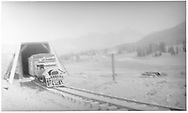 RGS Goose with Pierce Arrow body emerging northbound from snowshed at Lizard Head.<br /> RGS  Lizard Head, CO  ca. ? 1940