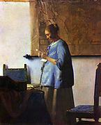 Johannes Vermeer (1632  – 1675 ) Dutch artist. 'Woman reading a letter'  or  'Woman in Blue Reading a Letter'. ca. 1662-1663