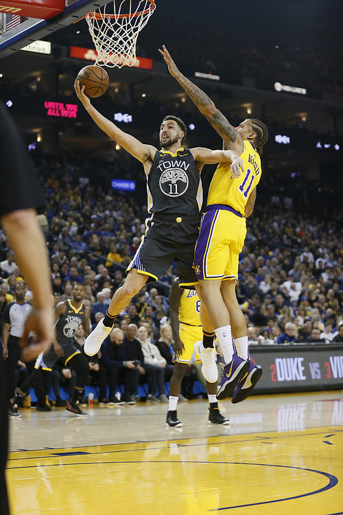 Golden State Warriors guard Klay Thompson (11) against Los Angeles Lakers forward Michael Beasley (11) in the first half of an NBA game at Oracle Arena on Saturday, Feb. 2, 2019, in Oakland, Calif.