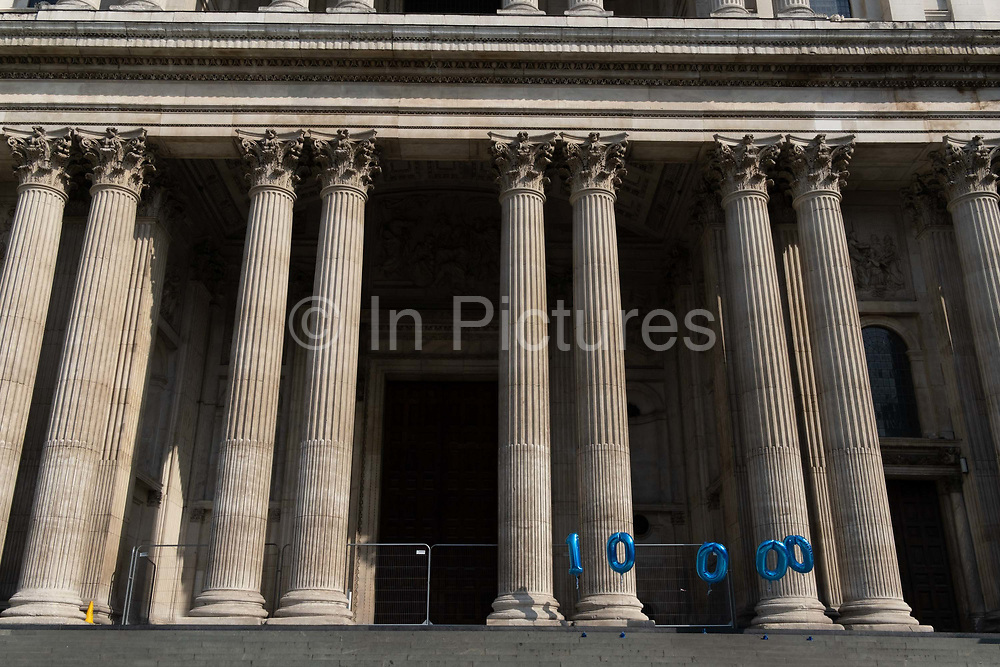 Balloons stand for 10,000 before writer and photographer Quintin Lake walks up the steps of St. Paul's Cathedral to greet his family after his epic 5-year, 10.000km walk around the entire coastline of the UK for his The Perimeter project, on 15th September 2020, in London, England.