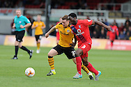 Mark Byrne (l) of Newport county holds off Femi Ilesanmi of York city. Skybet football league two match, Newport county v York city at Rodney Parade in Newport, South Wales on Saturday 5th Sept 2015.  pic by Andrew Orchard, Andrew Orchard sports photography.