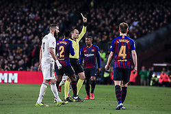 February 6, 2019 - Barcelona, Spain - The referee Mateu Laoz showing a yellow card during the semi-final first leg of Spanish King Cup / Copa del Rey football match between FC Barcelona and Real Madrid on 04 of February of 2019 at Camp Nou stadium in Barcelona, Spain  (Credit Image: © Xavier Bonilla/NurPhoto via ZUMA Press)