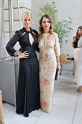 Left to right, MARISSA MONTGOMERY and OLGA VILSHENKO at the Vilshenko Mid-Summer Cocktail Party held at the Cafe Royal, 68 Regent Street, London on 20th June 2014.