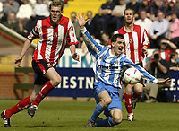 Photo Aidan Ellis, Digitalsport<br /> NORWAY ONLY<br /> <br /> Lincoln City v Huddersfield Town.<br /> Third Divison Play Off Semi Final 1st leg.<br /> 15/05/2004.<br /> Huddersfield's Andy Holdsworth is brought down in the area b ut no penalty was given