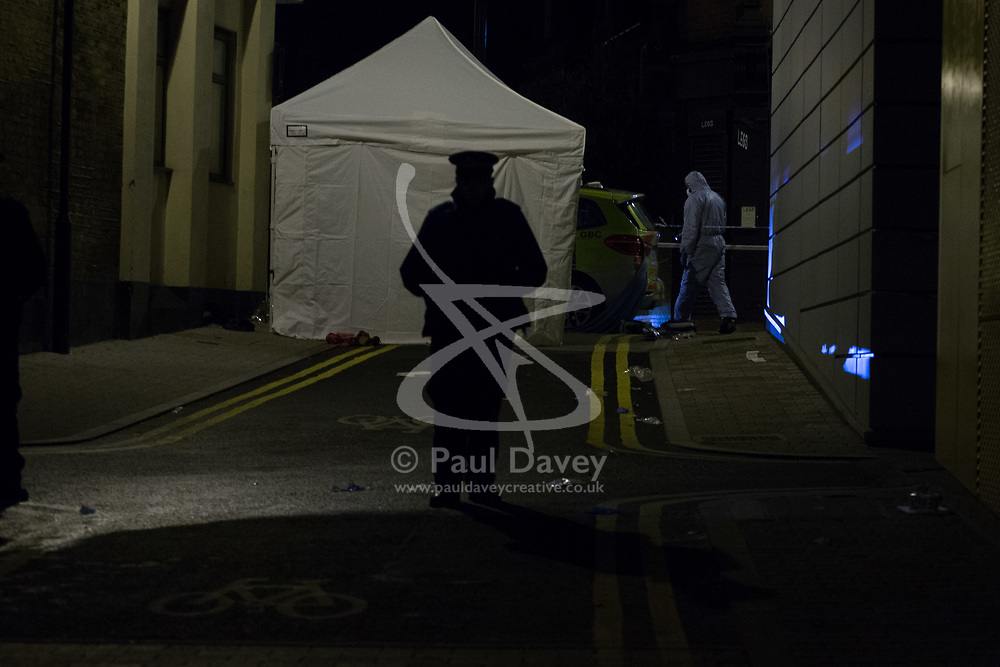 A white police tent covers the body of yet another victim of knife crime in the capita, this time in Morning Lane, Hackney. London, April 05 2018.