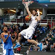 Anadolu Efes's Dogus Balbay (R) during their Turkish Basketball League match Anadolu Efes between Mersin BSB at Sinan Erdem Arena in Istanbul, Turkey, Saturday, January 14, 2012. Photo by TURKPIX