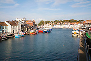 Colourful fishing boats in the harbour at Weymouth, Dorset, England, UK