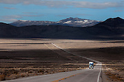 A truck is driving across Spring Valley, Nevada. South Nevada Water Authority (SNWA) has bought various ranches in this valley, securing the water rights that come along with the purchase of properties and land.