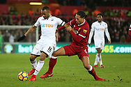 Jordan Ayew of Swansea city holds off Virgil van Dijk of Liverpool (r). Premier league match, Swansea city v Liverpool at the Liberty Stadium in Swansea, South Wales on Monday 22nd January 2018. <br /> pic by  Andrew Orchard, Andrew Orchard sports photography.