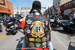 Riding down Main Street during the 78th annual Sturgis Motorcycle Rally. Sturgis, SD. USA. Tuesday August 7, 2018. Photography ©2018 Michael Lichter.