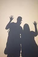 Shadow on beach of couple