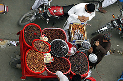 May 24, 2019 - Pakistan - PESHAWAR, PAKISTAN, MAY 23: Dates are being selling at a roadside stall as a demand of .Dates increase during the Holy Month of Ramadan-ul-Mubarak, at Faqirabad area in Peshawar .on Thursday, May 23, 2019. (Credit Image: © PPI via ZUMA Wire)