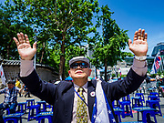 16 JUNE 2018 - SEOUL, SOUTH KOREA: A Korean evangelical Christian prays before a protest against South Korean President Moon Jae-in. Most of the protesters support jailed former President Park Geun-hye. Moon was elected in 2017 after Park was impeached, tried and convicted on corruption charges. The protesters allege that Moon is too soft on North Korea and can't be trusted to negotiate with North Korean leader Kim Jong-un. They support US President Donald Trump's efforts to negotiate with the North Korean strongman.  PHOTO BY JACK KURTZ