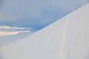 Mylène Jacquemart skins up Hallwylfjellet, Svalbard at sunset.