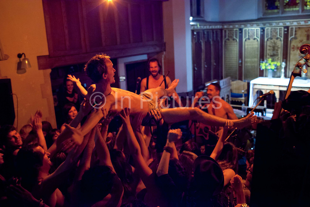 Ewan crowdsurfing in his pants, Stoke Newington Old Church. At the moment there is a quiet musical revolution going on in London - the city that has spawned so many important styles and movements, now has a bubbling experimental blues and folk scene, with many musicians independently recording and distributing their own albums through crowdfunding and social media without the need of large record labels and restrictive contracts. They play week in week out in a pleathora of small, independent, underground and makeshoft venues that have sprung up such as Jamboree and 14 Bacon Street.