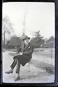 male person sitting in public park Paris 1900s