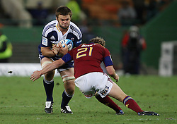 De Kock Steenkamp takes on Tony Brown during the Super Rugby (Super 15) fixture between the DHL Stormers and the Highlanders held at DHL Newlands Stadium in Cape Town, South Africa on 11 March 2011. Photo by Jacques Rossouw/SPORTZPICS