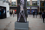Electronic sign showing a female figure walking in London, United Kingdom.