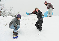Phillip Hendrickson, Katrina Hanks and Hailey Bolduc dusted off their sledding gear and enjoyed the new snow off Blueberry Lane in Laconia Tuesday morning.  (Karen Bobotas/for the Laconia Daily Sun)
