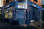 Shutters down at the closed William Hill betting shop and bookmakers during the third national coronavirus lockdown in Moseley, on 7th January 2021 in Birmingham, United Kingdom. Following the recent surge in cases including the new variant of Covid-19, this nationwide lockdown, which is an effective Tier Five, came into operation yesterday, with all citizens to follow the message to stay at home, protect the NHS and save lives.
