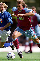 David Ginola (Aston Villa)  Robbie Savage (Leicester City). Leicester City v Aston Villa, 19/8/2000, F.A. Carling Premiership. Credit : Colorsport / Matthew Impey.