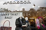 Op de Werelddag voor Fatsoenlijk werk delen de Stoere Vrouwen lintjes uit aan Fair Wear kledingwinkels in Amsterdam. Deze kledingwinkels zorgen voor goede werkomstandigheden. De actie is tevens het slot van de campagne 'Eerlijke Kleding? Draag het uit' die de vakbond CNV Internationaal in 2010 gestart is.<br /> <br /> A store of McGregor at the P.C. Hoofstraat in Amsterdam is decorated for being part of the Fair Wear Foundation (FWF) at the World Day for Decent Work. With the decoration a campaign of trade union CNV Internationaal to promote decent work has ended.