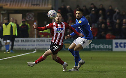 Niall Mason of Peterborough United in action wit Jack Payne of Lincoln City - Mandatory by-line: Joe Dent/JMP - 01/01/2020 - FOOTBALL - Sincil Bank Stadium - Lincoln, England - Lincoln City v Peterborough United - Sky Bet League One