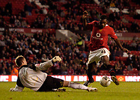 Photo: Jed Wee.<br /> Manchester Utd v Barnet. Carling Cup. 26/10/2005.<br /> <br /> Manchester United's Sylvan Ebanks-Blake (R) avoids the tackle of Barnet goalkeeper Scott Tynan to score.