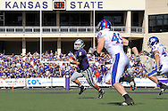 MANHATTAN, KS - NOVEMBER 07:  Quarterback Grant Gregory #6 of the Kansas State Wildcats rolls to the outside against pressure from defenders Drew Dudley #49 and Justin Springer #45 of the Kansas Jayhawks in the second quarter on November 7, 2009 at Bill Snyder Family Stadium in Manhattan, Kansas.  (Photo by Peter G. Aiken/Getty Images)