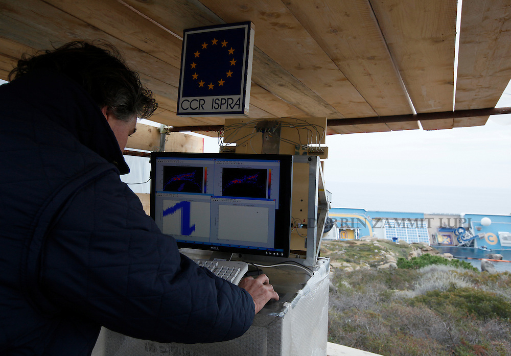 Radar technician Marco Basso looks at monitors showing movement of the cruise liner Costa Concordia off the west coast of Italy at Giglio island January 31, 2012. Geologists monitoring the movement of the capsized cruise ship Costa Concordia are doing so with the help of technology normally used for volcanoes and landslides.  Italian authorities have ended the search for bodies on the submerged sections of the ship, more than two weeks after the giant cruise liner capsized off the Tuscan coast, officials said on Tuesday.  A fire brigade spokesman says the ship's recent movements led to the indefinite suspension...REUTERS/Darrin Zammit Lupi (ITALY)