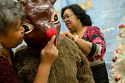 Rudolf the red nosed Reindeer, as well as Mr. and Ms Santa made an appearance at the winter fest celebration at the Free Library branch in Olney, on December 16, 2018. (Bastiaan Slabbers for WHYY)