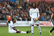 Renato Sanches of Swansea city ® holds on to the ball after his teammate Leroy Fer (on ground) is fouled. Premier league match, Swansea city v Newcastle Utd at the Liberty Stadium in Swansea, South Wales on Sunday 10th September 2017.<br /> pic by  Andrew Orchard, Andrew Orchard sports photography.
