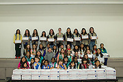 Girl Scouts pose for a group photo with 50 boxes of Holiday Cards created special for the U.S. Military during the Girl Scout USA of Northern California Operation Holiday Cards packing event at Mount Olive Ministries in Milpitas, California, on November 18, 2015. (Stan Olszewski/SOSKIphoto)