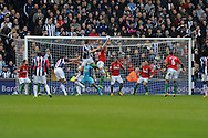 WBA's Gareth McAuley's (23) header is deflected in off Swansea's Jonathan De Guzman (3rd from right) for an own goal, WBA's 2nd goal.  Barclays Premier league, West Bromwich Albion v Swansea city at the Hawthorns stadium in West Bromwich, England on Saturday 9th March 2013.  pic by  Andrew Orchard, Andrew Orchard sports photography,
