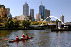 Men rowing on Yarra River in centre of Melbourne in Australia