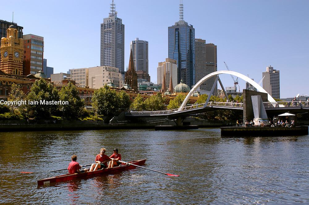 Men rowing on Yarra River in centre of Melbourne in Australia