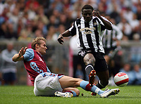 Photo: Rich Eaton.<br /> <br /> Aston Villa v Newcastle United. The Barclays Premiership. 27/08/2006. left olof Mellberg of Aston Villa tackles  Newcastles Obefami Martins