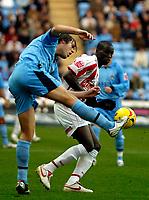 Photo: Ed Godden.<br />Coventry City v Stoke City. Coca Cola Championship. 02/12/2006. Coventry's Elliott Ward (L), clears the ball past Mamady Sidibe.