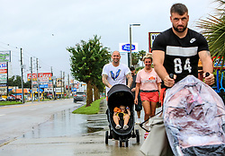 Visiting from Scotland, Alex Hardie and Natalie Hardie Photo by background) and Greg Ritchie Photo by front) walk with their families down a nearly deserted International Drive in Orlando, FL, USA. on Sunday, September 10, 2017 as wind and rain from Hurricane Irma arrives in Central Florida. Photo by Jacob Langston/Orlando Sentinel/TNS/ABACAPRESS.COM
