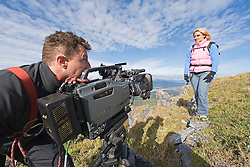 Filmmaker shoots on a mountain near Whitehorse