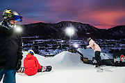 Snowboarders Chase Josey, left, Maddie Mastro and Ruki Tomita practice in the superpipe as the sun sets over the venue at Buttermilk during the 2021 X Games in Aspen, Colorado.