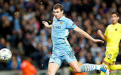 18.10.2011, City of Manchester Stadion, Manchester, ENG, UEFA CL, Gruppe A, Manchester City (ENG) vs FC Villarreal (ESP), im Bild Manchester City's Edin Dzeko sees the equalising 1-1 goal go in against Villarreal CF// during UEFA Champions League group A match between Manchester City (ENG) and FC Villarreal (ESP) at City of Manchester Stadium, Manchaster, United Kingdom on 18/10/2011. EXPA Pictures © 2011, PhotoCredit: EXPA/ Propaganda Photo/ Vegard Grott +++++ ATTENTION - OUT OF ENGLAND/GBR+++++