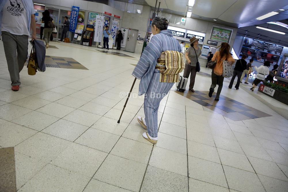 Japanese elderly traditional dressed woman commuter at Shibuya train station