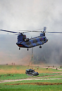 Chinook helicopter lifts a tank at display given by the 5th Airborne Brigade at Salisbury Plain, Wiltshire, UK