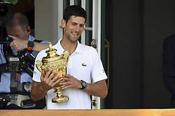 LONDON, July 16, 2018  Novak Djokovic of Serbia shows his trophy after winning the men's singles final match against Kevin Anderson of South Africa at the Wimbledon Championships 2018 in London, Britain, on July 15, 2018. Novak Djokovic won 3-0. (Credit Image: © Stephen Chung/Xinhua via ZUMA Wire)