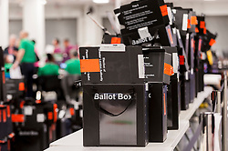 © Licensed to London News Pictures. 06/05/2016. London, UK. A stack of empty ballot boxes awaiting collection. Votes for the London Mayoral elections and London Assembly Members are collated and counted at Olympia in Kensington, one of three official counting houses. Photo credit : Stephen Chung/LNP
