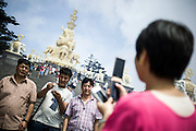 Chinese people take pictures in front of the Elephant golden statue during their pilgrimage at the temple on the top of the Buddhist sacred mountain of Emei Shan, Sichuan, August 13, 2014. <br /> <br /> Smartphones are an essential tool of Chinese ordinary life. Everywhere in China, people use them to take pictures to share online, to talk and chat, to play videogames, to get access to the mainstream information, to get connected one each other. In the country where the main global social media are forbidden - Facebook, Twitter and Youtube are not available  -, local social networks such as WeChat have a wide spread all over the citizens. The effect is an ordinary and apparently compulsive way to get easy access to digital technology and modern way of communication. <br /> A life through the display. Yes, We Chat.<br /> <br /> © Giorgio Perottino