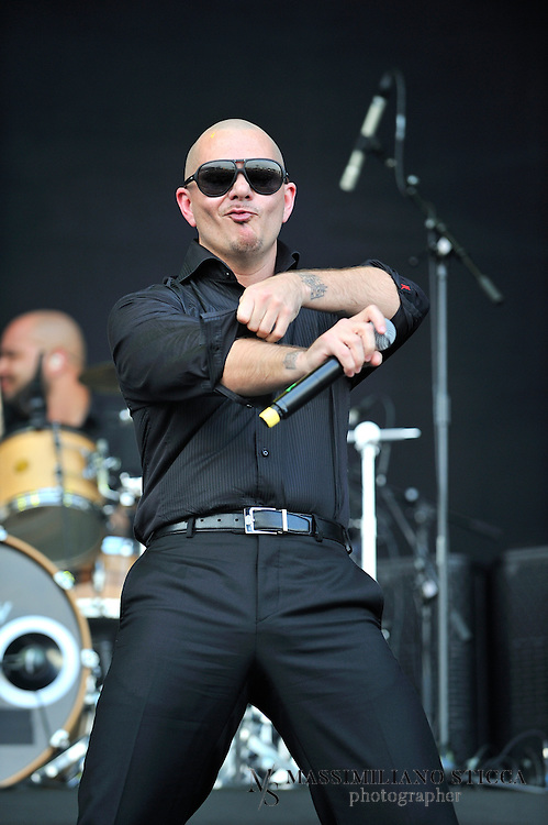 """Heineken Jammin Festival 2012 <br /> Armando Pérez (born January 15, 1981), better known by his stage name Pitbull, is an American rapper, songwriter, and record producer. His first recorded performance was from the Lil Jon album Kings of Crunk in 2002. In 2004, he released his debut album titled M.I.A.M.I. (short for Money Is A Major Issue) under TVT Records. He released El Mariel in 2006 and The Boatlift in 2007.[3] In 2009, the album Rebelution spawned the hit single """"I Know You Want Me (Calle Ocho)"""". Pitbull's 2011 album, Planet Pit, featured the single """"Give Me Everything"""" which was his first number-one single on the Billboard Hot 100. The song reached #1 worldwide and featured artists Ne-yo, Nayer, and Afrojack."""